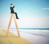 Businessperson on ladder, research concept
