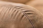 Sofa Edge Detail Texture of Brown Leather with Stitching