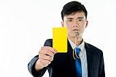 Young businessman holding yellow card