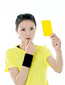 Young asian woman holding yellow card
