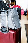 Luggage waiting in hotel lobby