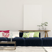 Blue sofa and a wooden console with a canvas