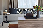 stylish living room design with grey striped pillows on sofa