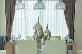Decorative silver jars on dining table in modern classic decoration