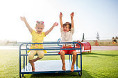 Carefree children having fun on a playground.