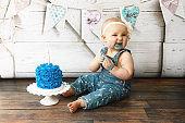 Baby Girl Eating Her First Birthday Cake