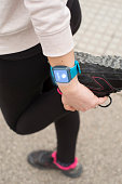 Young woman wearing smart watch while doing sports