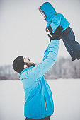 Father and Son Playing in Winter Forest Snowstorm