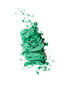 green crumbled eyeshadow on white background