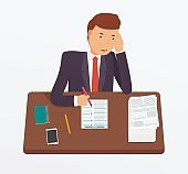 Businessman busy with documents.