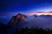 Bukhansan mountains is covered by morning fog and sunrise.