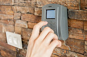 Human hand pressing on security combination code to unlock
