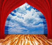 Red curtain in front of Sky background with wooden floor