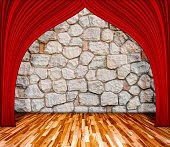Red curtain in front of rock background with wooden floor.