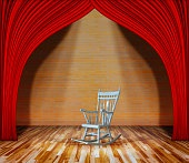 Rocking chair on stage.