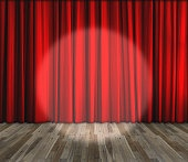 lighting on stage with red curtain and wooden floor