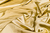 abstract background crumpled or wavy folds of fabric texture