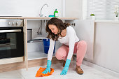 Woman Wiping Floor
