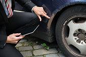 Insurance Agent Examining Car Damaged