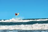 Water Sports. Kiteboarding, Kitesurfing. Surfer Surfing Waves.
