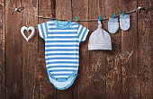 Baby background. Baby clothes hanging on the clothesline