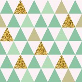 Seamless pattern with gold triangles.