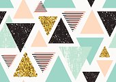Seamless pattern with gold glitter triangles.
