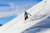 Snowboarder going downhill