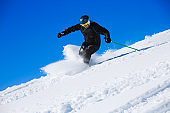 Mature men off piste skiing  powder snow  sunny ski resorts