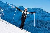 Woman snow skier on ski vacation