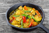 curry with vegetables stewed in a frying pan,, close-up