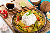 vegetarian curry with rice, coconut, ginger, soy sauce top view