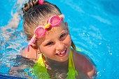 Child on water slide in aquapark.
