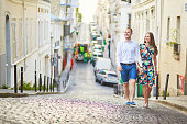 Young romantic couple walking on Montmartre