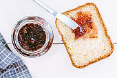 Toast with strawberry jam on wooden table