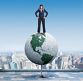 Businesswoman Standing On Top Of Globe