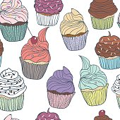 Seamless vector colorful cupcakes on white background.