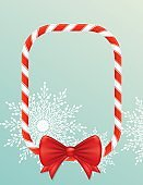 Christmas Candy Cane Border With Bow and Snowflakes