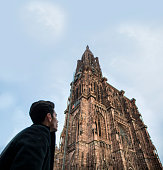 Man near Cathedral of Strasbourg in France