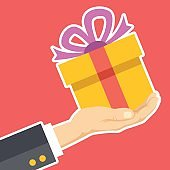 Hand holding gift box. Congratulations, receive or give giftbox, surprise