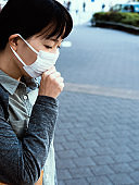 Woman with a mask coughing