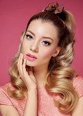 Beautiful Blonde Girl. Healthy Long Curly Hair.Pink dress