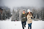 Carefree couple having fun in the snow