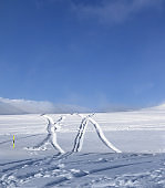 Off-piste ski slope with new-fallen snow and traces from ski, snowboard after snowfall
