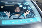 young woman riding the self driving car. autonomous car.
