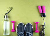 Flat lay shot of sneakers, jumping rope.