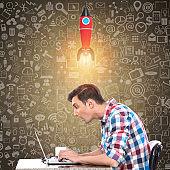 Shocked businessman working on laptop