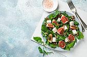 figs, arugula, feta cheese and pecan nuts salad