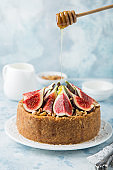 delicious cheesecake  served with fresh figs, nuts and honey