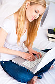 Student studying in bed
